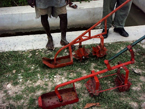 Photo: Two cono-weeders, in the back a model provided by the Taiwanese who imported it from Domenican Republic, in the front, locally manufactured weeder ( metal used was heavier, thus weeder operation became more difficult compared to Taiwanese weeder), Les Cayes, Haiti, September 2010 [Photo by Erika Styger]