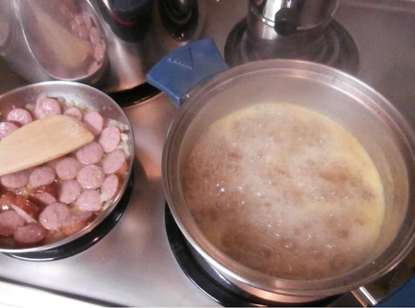 Meanwhile, melt butter in fry pan, brown garlic add, onions, meat. i saute until...