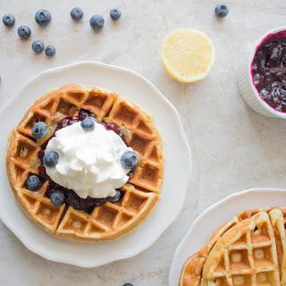 Lemon Poppy Seed Waffles with Lemon Curd & Blueberry Syrup.