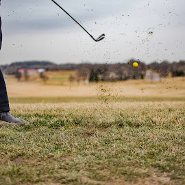 Practice by Duane Vosika - Sports & Fitness Golf ( practice, golfball, nature, cold, nebraska, nikon, drivingrange, driving, golf, omaha, tee, grass, club, golfclub )