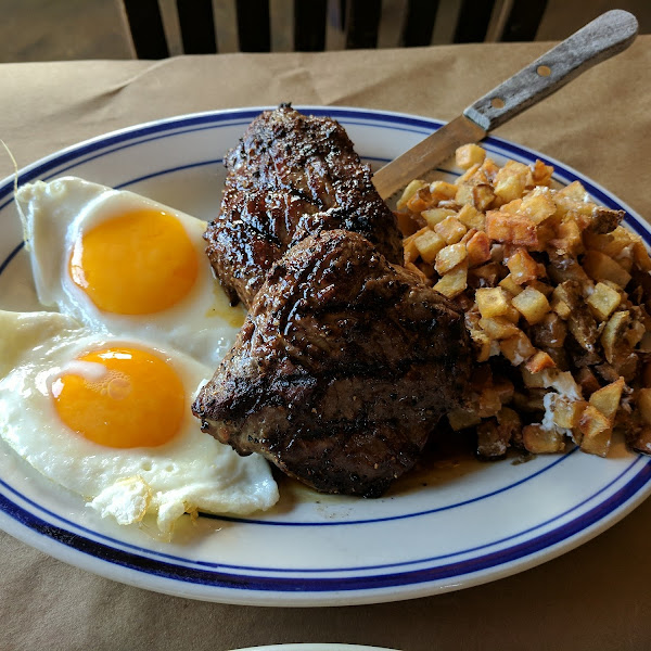 Steak, eggs, and Ash browns with goat cheese
