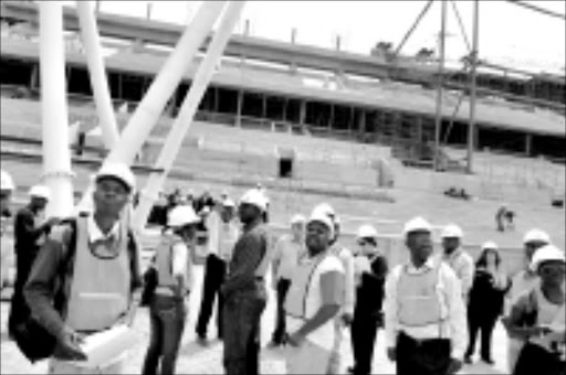 WORK PROGRESS: Journalists from print and electronic media were inspecting the progress of the new Peter Mokaba 2010 Complex Stadium on Monday (yesterday). This stadium is schedulled to complete next year in June. Although the construction workers were on strike several times, but the progress of the stadium is highly impressed and show the direction. PHOTO: ELIJAR MUSHIANA