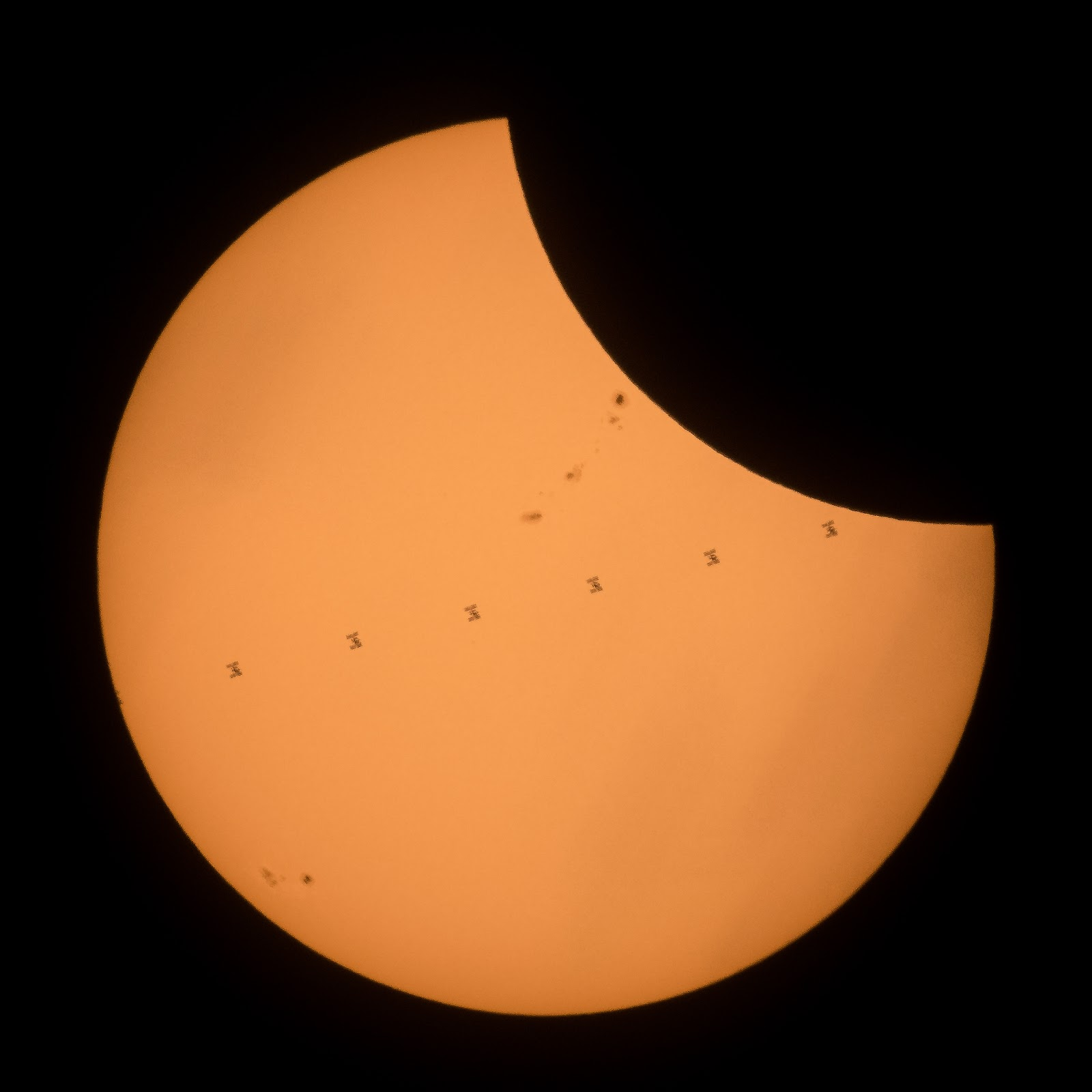 ISS transit across the sun while eclipsed by the moon