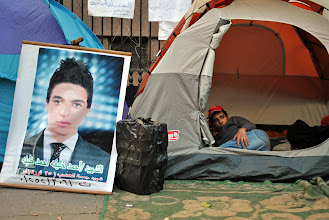 Photo: A banner of one of the martyred youth from the battle of Mohamad Mahmoud St. is placed outside a tent at the sit-in on Magles el Shaab St. where the Cabinet building is located.