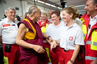 Photo: His Holiness the Dalai Lama joking with staff at the Vienna Stadthalle after his talk in Vienna, Austria, on May 25, 2012. Photo/Tenzin Choejor/OHHDL