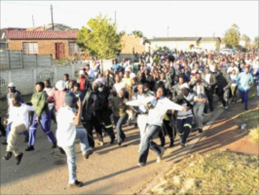 CHAOTIC: A 17-year-old boy was killed after police used live ammunition at a service delivery protest that led to the arrest of 11 people during a clash between police and residents of Siyazenzela township in the eastern highveld of Mpumalanga on Easter Monday. Pic: Adrew Hlongwane. 06/04/2010. © Sowetan.