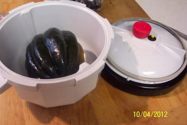 Wash squssh.Set up tender Cooker. Pierce the squash  10-15 times with a fork. Place i...