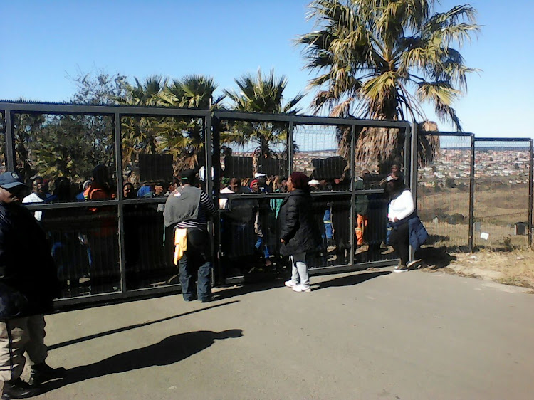 About 50 workers staged a four-hour protest when they locked the gates of the cemetery at 8am.