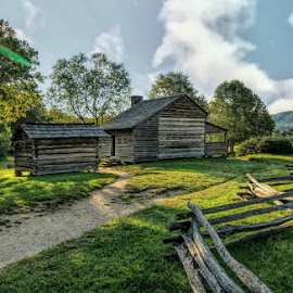 Homestead by Karen Carter Goforth - Buildings & Architecture Public & Historical ( sky, country, grass, cabin, house, fence, trees, sun, home,  )