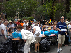 Photo: Volunteers with trays of cups of water for the marchers.  The Heritage of Pride gay pride march, Fifth Avenue and 12 Street, Greenwich Village, 26 June 2011. (Photograph by Elyaqim Mosheh Adam.)