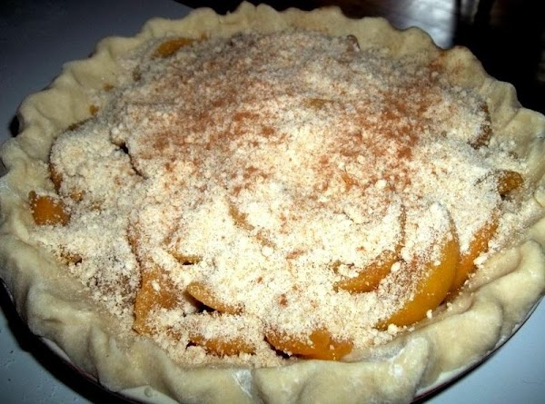 Add the peaches, spreading out evenly. Sprinkle the remaining crumbs over the peaches and...