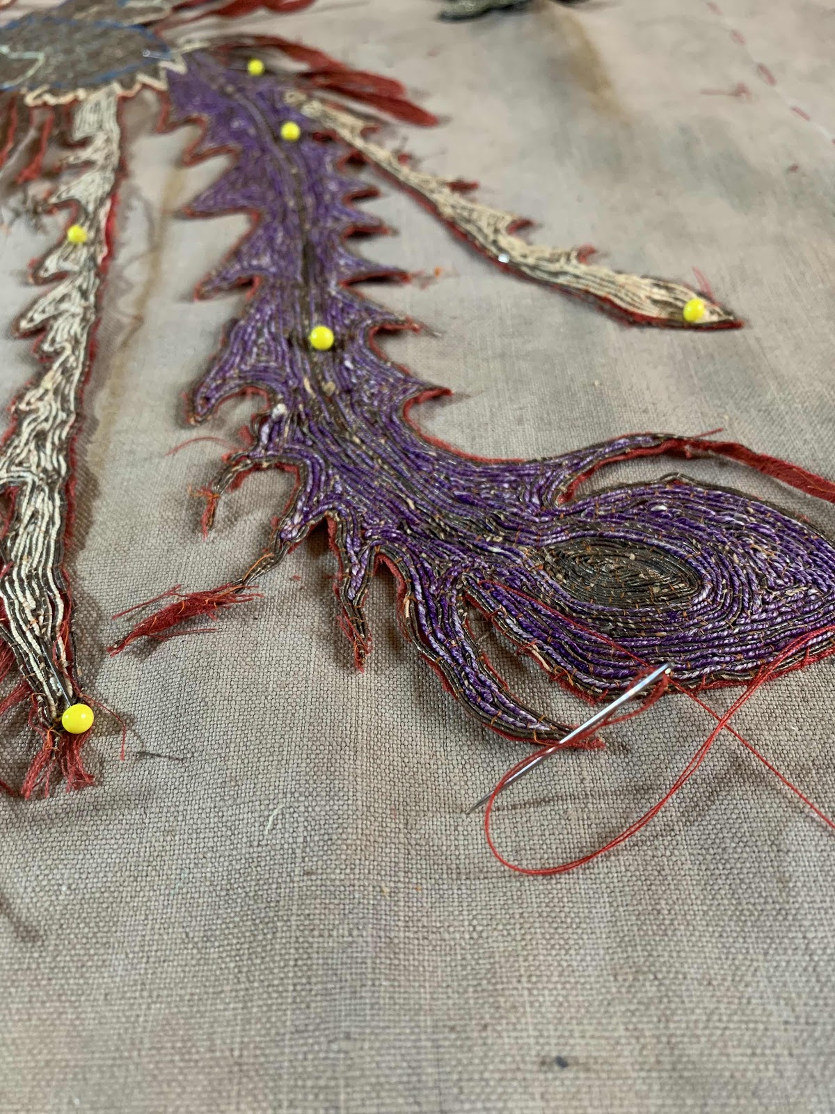 closeup of Phoenix embroidery being stitched onto fabric