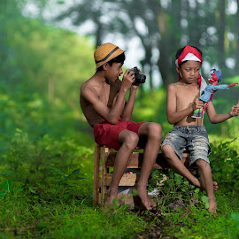 by Eko Probo D Warpani - Babies & Children Children Candids ( canon, strobist, green, nikkor, children, candid, tamron, sony, child, playing, colour, flag, nature, village, color, happy, indonesia, nikon, tokina,  )