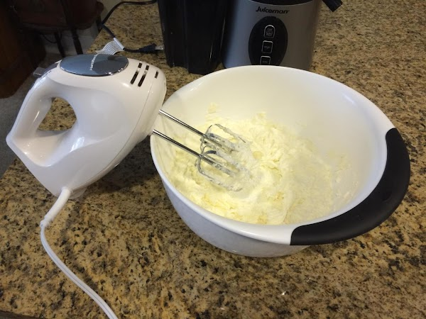 On low speed with a hand mixer, cream together the softened butter and the...