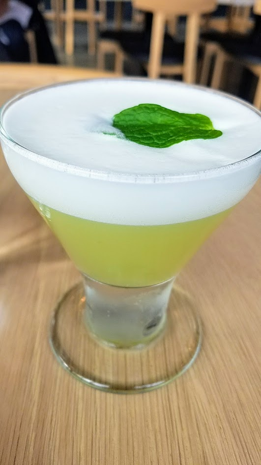 Afuri's Endomame cocktail with mint and house sugar snap pea vodka, freshly pressed lemon juice, simple syrup, and egg white