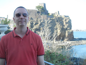 Photo: Chris with Aci Castello castle in the background