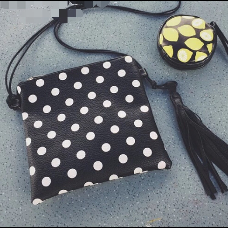 Polka Dots Fringe Sling Bag by Vogue Malaysia Official