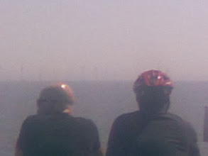 Photo: The turbines 5Km away in the sea mist, dome-inated by a couple of spectators.