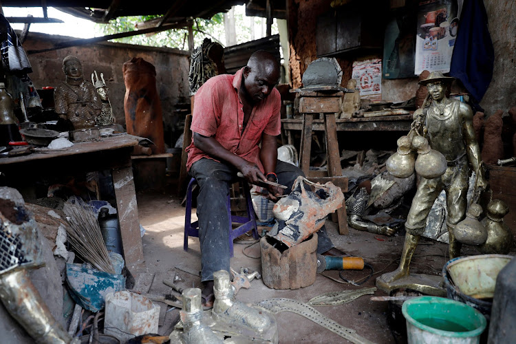 Local bronze sculptor Eric Ogbemudia, 62, works in his studio on Igun street in Benin City, Edo state, Nigeria.