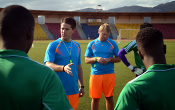 Photo: Coach McKinstry and Assistant Tom Harris speak with players [Training Camp ahead of Leone Stars v Swaziland May 2014 (Pic: Darren McKinstry)]