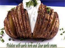 Potatoes With Garlic Herb And Sour Garlic Cream.