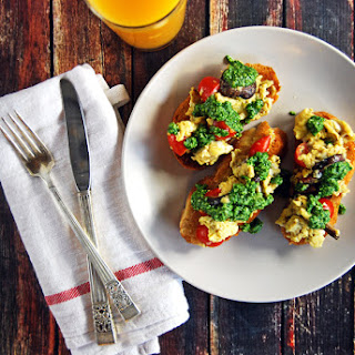 Scrambled Egg Toasts with Mushrooms, Cherry Tomatoes, and Spinach Pesto