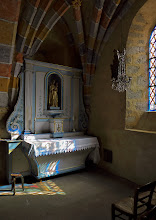 Photo: Blue Altar - Monceaux-sur-Dordogne - Late-afternoon sun through the stained-glass at right projected the window's image onto the altar. It was really dark in there, and a photographic challenge to bring out detail in the chapel without washing out the projected image.