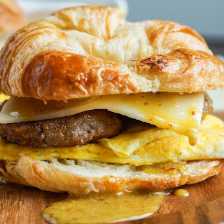 Sausage Egg and Cheese Croissants with Maple Dijon Sauce