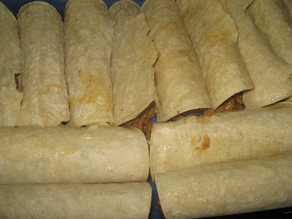 Spoon a portion of the meat mixture down the middle of each tortilla and...