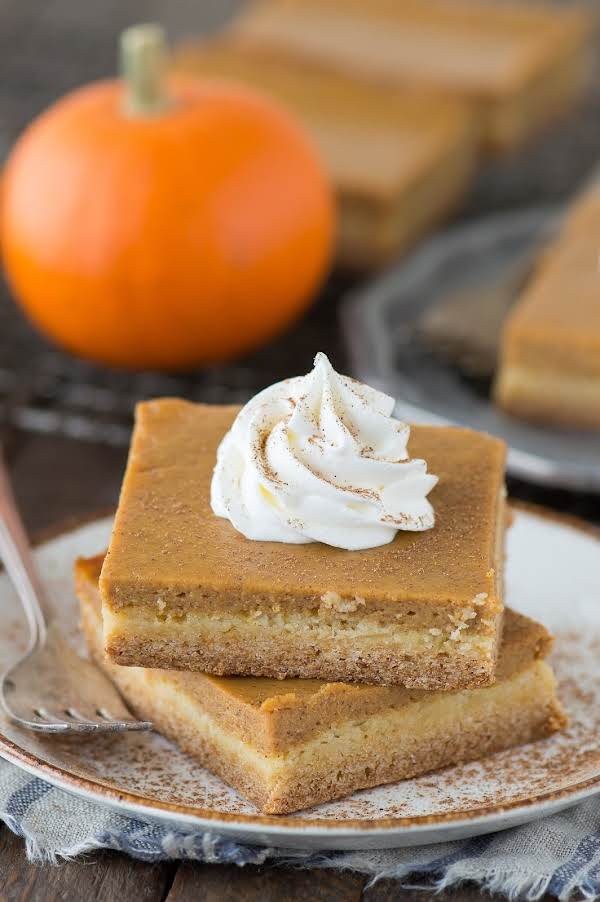 Delicious Layers Of Cake And Pumpkin Custard In Easy To Cut Bars To Serve  For Thanksgiving Dessert Or Anytime. A Dollop Of Whipped Topping Or Real Whipped Cream Would Make It Even More Attractive  Enjoy!