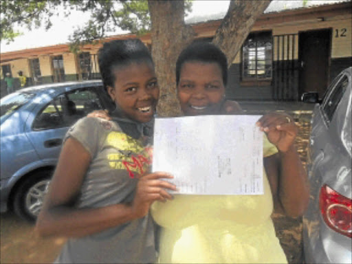LUCKY ONE: Regolotswe High School Grade 10 pupil Ntswaki Mooki and her mother Ntheboleng celebrate after finding out that she had actually passed. Photo: Boitumelo Tshehle