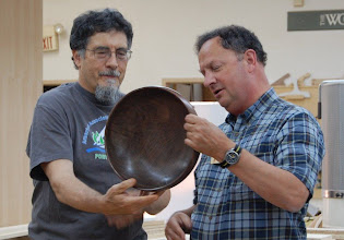 "Photo: Clif hands off a wonderful 12"" walnut bowl to its maker, Stan Wellborn."