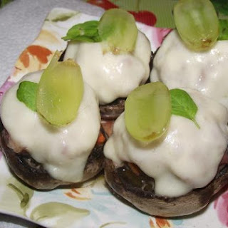 Button Mushrooms stuffed with minced meat with lemon basil and grapes..