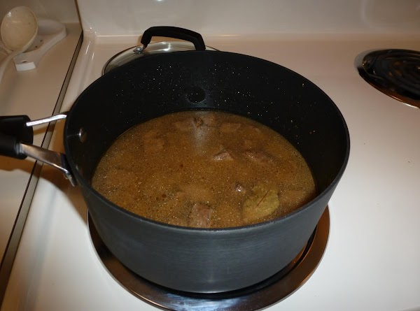 Add enough boiling water to cover the meat then lower the heat and simmer...