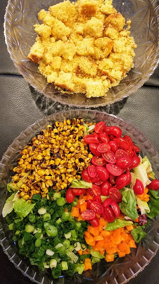 Recipe for cornbread salad - my version is an actual salad with romaine lettuce, and I omitted the beans but you can add the if you'd like just need a bigger bowl to put your salad in! I also served the bacon crumbles on the side so it could be vegetarian by default