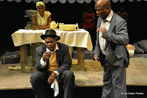 City struggles:  Masasa Mbangeni (back), Siyabonga Twala (left) and John Lata turn in fine performances in the cathartic play The Suitcase, based on the short stories of Es'kia Mphahlele. Picture: IRIS DAWN