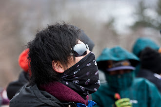 Photo: Skier Yuya Yamada of Japan waits for the opening ceremony to begin at the Harris Hill Ski Jump in Brattleboro on Sunday.(Zachary P. Stephens/Brattleboro Reformer)
