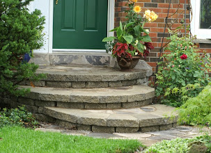 Photo: An old concrete porch was removed and replaced with this melding of natural and cast stone.
