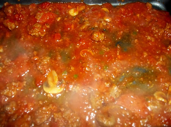 Now, get your pan, and ladle enough sauce to swirl around and cover the...