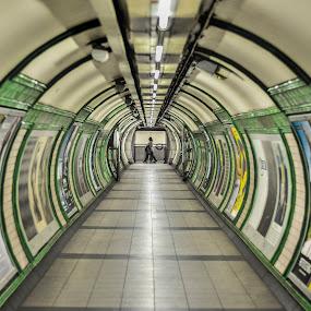 Going Underground by Karen Buttery - Buildings & Architecture Architectural Detail ( architechture, london, tube, single person, street, walkway, underground, tunnel )