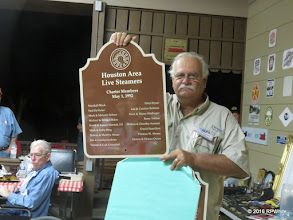 Photo: Greg Moore holding up the Charter Member sign he made for display at HALS.