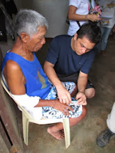Photo: Nurse Sean Velchez, president of the National Orthopedic Center Employees Association-Alliance of Health Workers treating an elderly patient