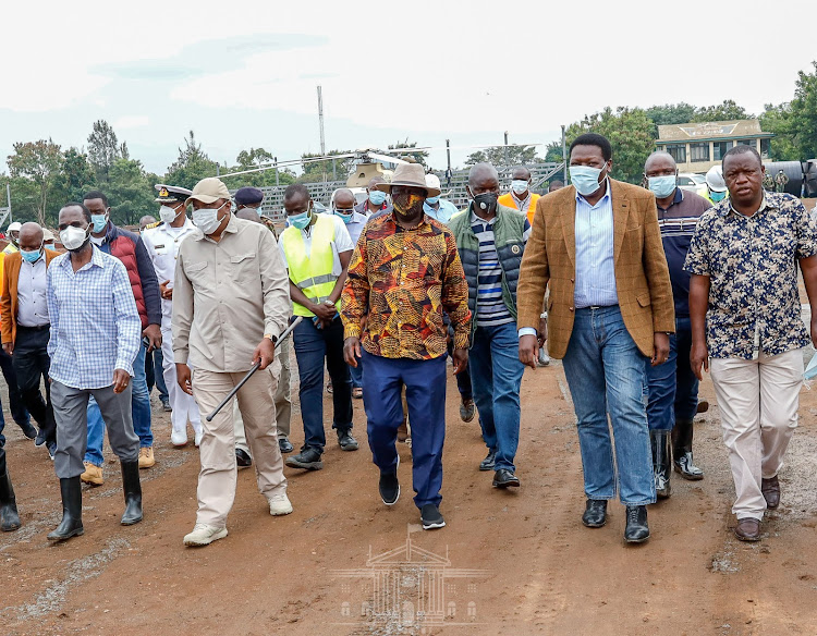 President Uhuru Kenyatta accompanied by former Prime Minister Raila Odinga and Chief of Defence Forces General Robert Kibochi, when he inspected the ongoing construction of the Sh415 million Jomo Kenyatta Stadium in Mamboleo, Kisumu County on January 10, 2021.