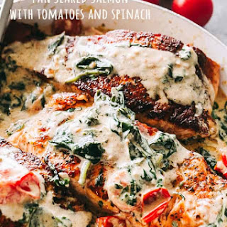 Creamy Pan Seared Salmon with Tomatoes and Spinach.