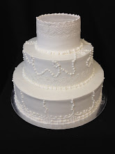 Photo: Pearl & lace vintage wedding cake featuring lace overlay and beautiful piping work.