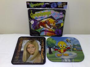 Photo: 1990s mouse pads, Goosebumps Monster Blood II, Buffy The Vampire Slayer, Tweety Bird