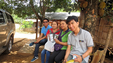 Photo: Wi and Arm at Lahu home with Pon and Kanda (volunteer healthcare workers HIV+)