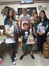 Photo: Kenny, Hailey, Rachel, Matthew, Elizabeth, Brenna Kylee and Nico after packing kare kits.