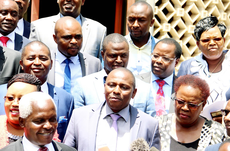 Kikuyu MP Kimani Ichung'wah and other Jubilee MPs address the press at Parliament Buildings