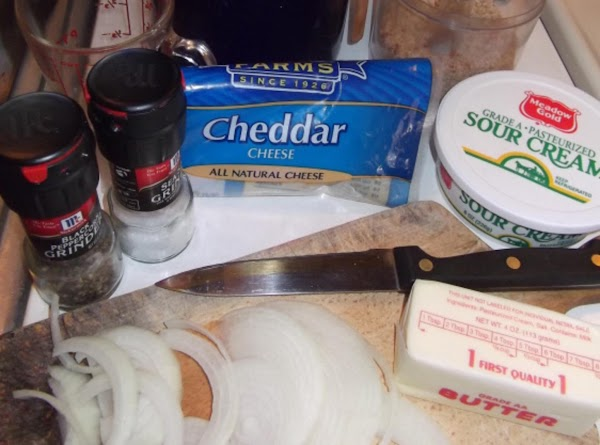 Cut onion into thin slices.  Saute onion in 1/2 stick butter (or margarine)....